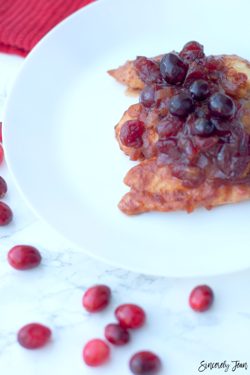 Recipe for cranberry bbq chicken - by SincerelyJean.com. And it only has five ingredients!