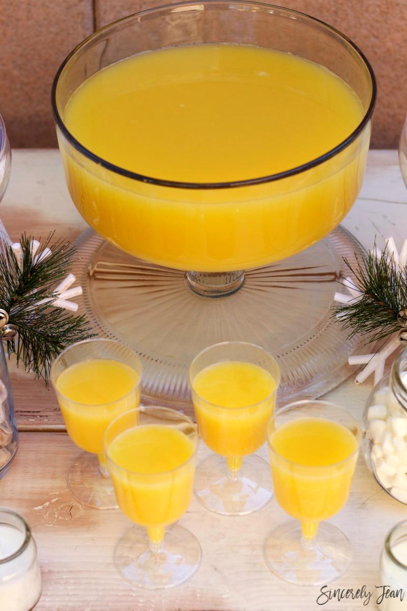 Christmas brunch tablescape and virgin mimosa recipe by SincerelyJean.com