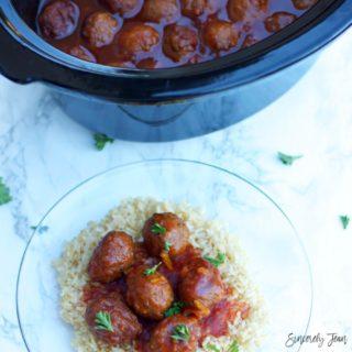 Warm winter recipe for dinner or appetizer: SincerelyJean.com Crock Pot Cranberry Orange Meatball Recipe